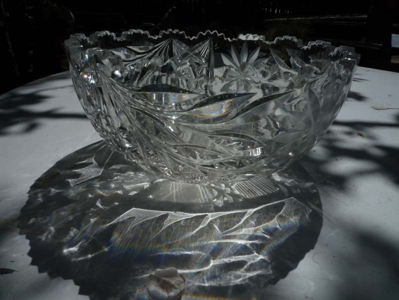 shadows froma cut glass bowl ona white surface